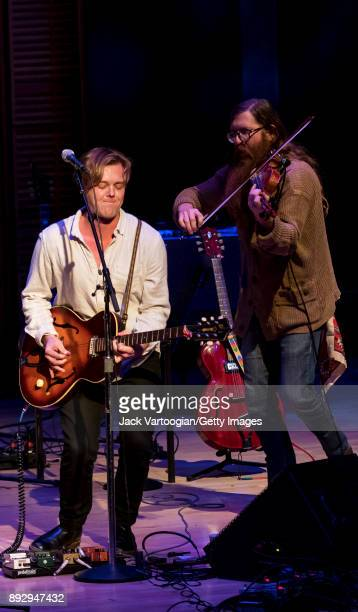 American AltCountry musician Parker Millsap plays guitar as he leads his band which includes Daniel Foulks on fiddle during a performance in the...