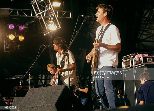 American alternative rock group Foo Fighters performing on stage 1998 Left to right Nate Mendel Dave Grohl and Franz Stahl