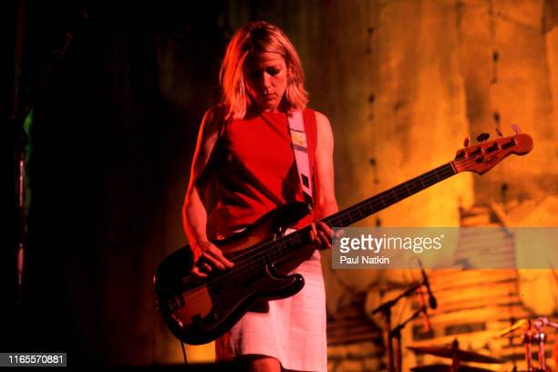 American Alternative Rock musician Kim Gordon of the group Sonic Youth plays bass guitar as she performs onstage at the World Music Theatre Tinley...
