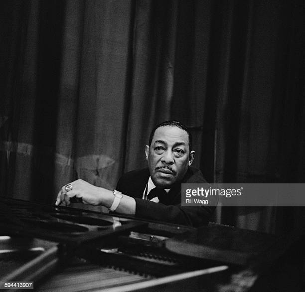 American alto saxophonist Johnny Hodges at the piano circa 1960