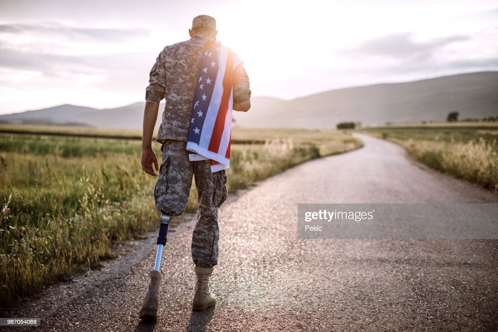American Amputee Soldier On Road : Stock Photo