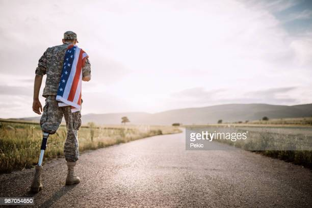 american amputee soldier on road - injured u.s. army stock photos and pictures