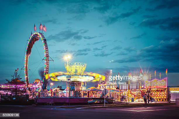 american amusement park evening scene with lights and motion - robb reece bildbanksfoton och bilder