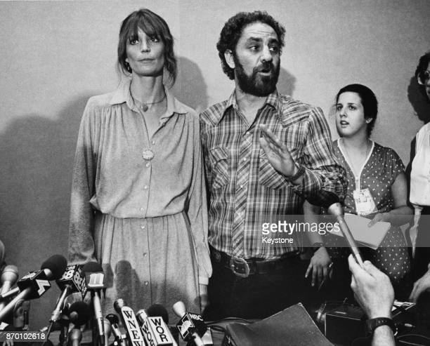 American anarchist and social activist Abbie Hoffman with his girlfriend Johanna Lawrenson after his arrest in Manhattan for skipping bail in 1974 on...
