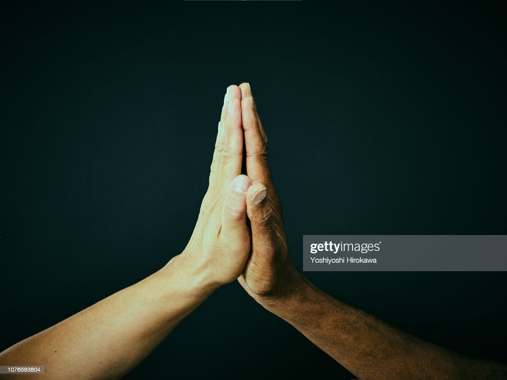 American and a Japanese hand to hand : Stock Photo