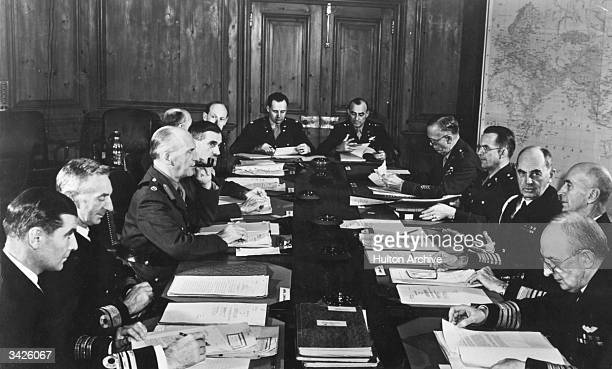 American and British military leaders in conference Amongst those seated round the table are British representatives Rear Admiral Wilfrid Rupert...