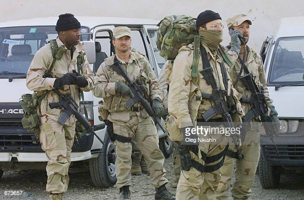 American and British special opereation soldiers meet during fighting between the Northern Alliance and proTaliban forces November 27 2001 in a...