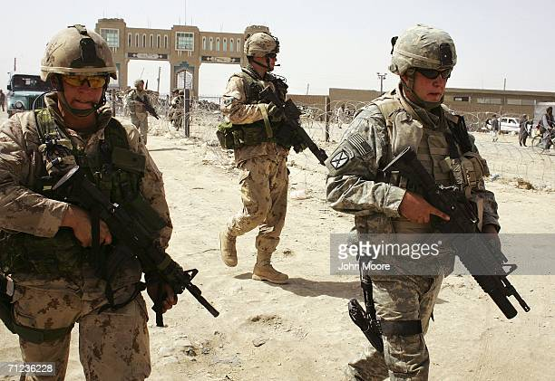 American and Canadian soldiers walk near the AfghanPakistan border crossing in support of Operation Mountain Thrust on June 19 2006 at Spin Boldak...