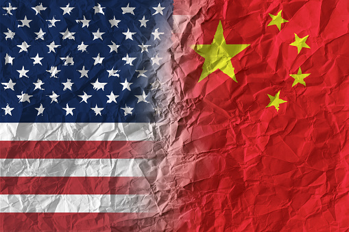 American and Chinese flags on crumpled paper, diplomatic crisis 971195458