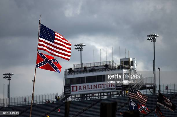 American and Confederate flags are seen flying over the infield campground prior to the NASCAR Sprint Cup Series Bojangles' Southern 500 at...