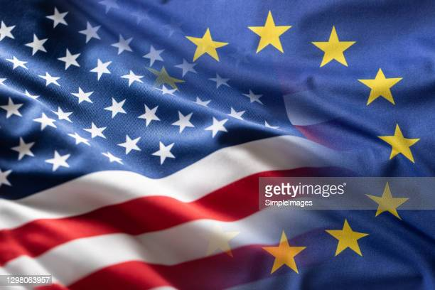american and european union flags together. cooperation between the united states of america and the european union. - american culture stock pictures, royalty-free photos & images