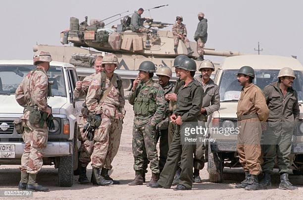American and Iraqi military officers discuss the exchange of their prisoners after Iraq was defeated in the Gulf War