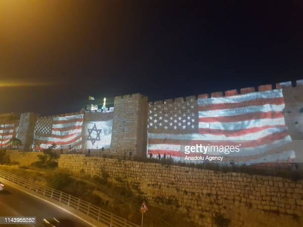 American and Israeli flags are reflected on walls of Jerusalem within a ceremony marking the one year anniversary of the move of the United States...