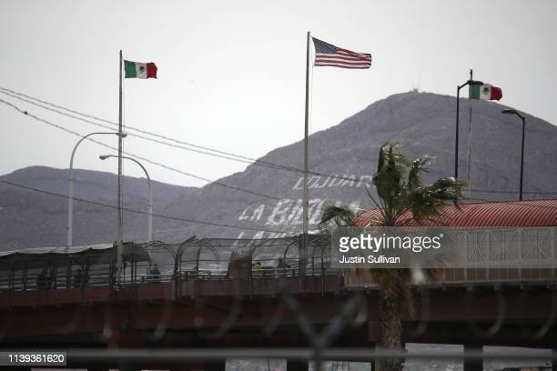 American and Mexican flag fly over the Paso del Norte International Bridge on March 30 2019 in El Paso Texas US President Donald Trump has threatened...