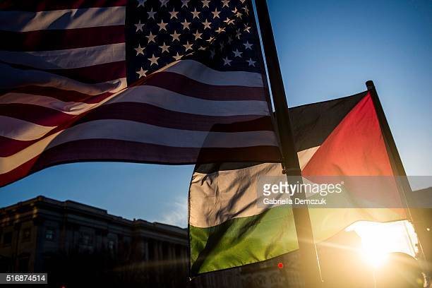 American and Palestinian flags wave outside of the Verizon Center during the American Israel Public Affairs Committee conference on March 21 2016 in...