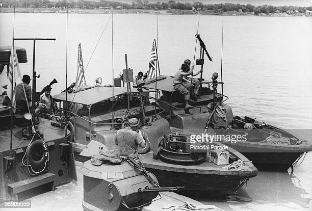 American and South Vietnamese patrol boats on the Mekong River near Neak Leung after their forces captured the Cambodian town 25th May 1970 They are...