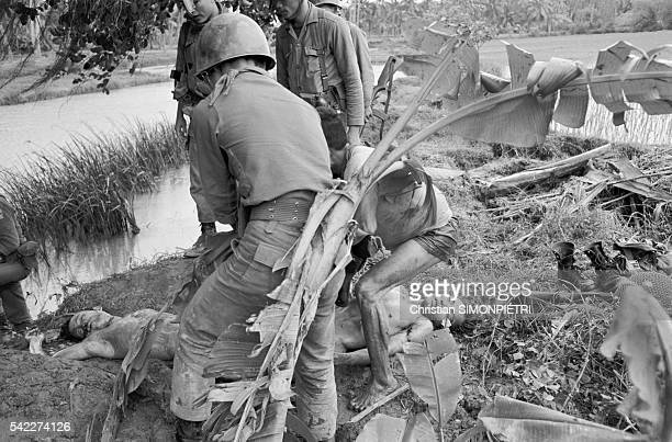 American and South Vietnamese troops discover a mass grave containing Vietcong bodies during a search operation for missing French journalist Michele...