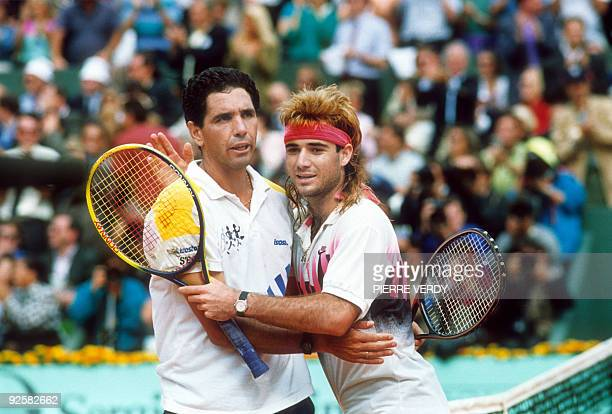 American Andre Agassi congratulates his Ecuadorian opponent Andres Gomez winner of the Men's singles of the French Open final on june 10 1990 at...