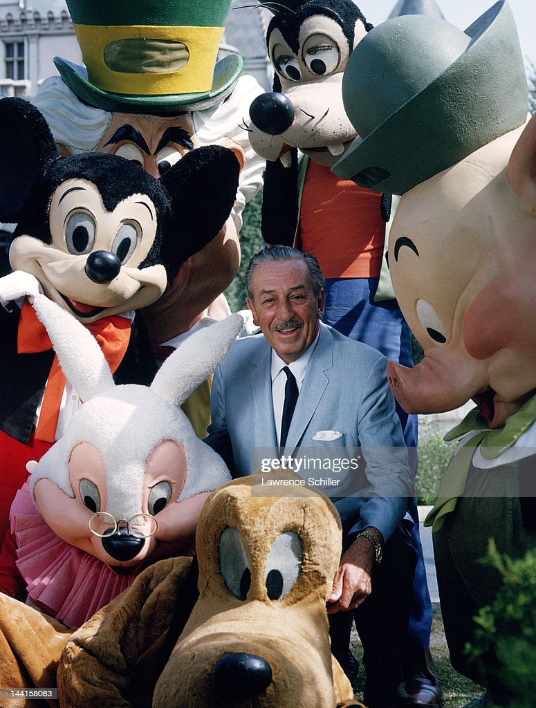 American animator and film director Walt Disney (1901 - 1966) poses with actors costumed as some of his company's famous creations, Anaheim, California, November 1964. Among them are Mickey Mouse, the Mad Hatter, Goofy, one of the Three Little Pigs, Pluto, and a rabbit.