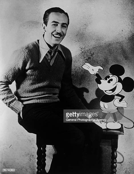 American animator and producer Walt Disney with one of his creations Mickey Mouse.