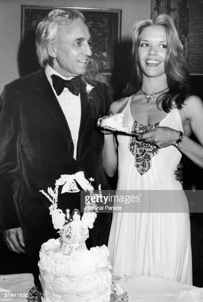 American AP supermarket chain heir and art collector Huntington Hartford and his fourth wife model Elaine Kay stand side by side with their wedding...
