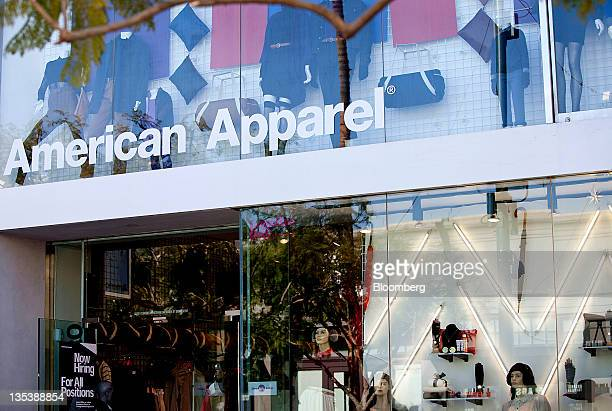 American Apparel Inc signage is displayed outside of a store at the Third Street Promenade outdoor mall in Santa Monica California US on Monday Dec 5...