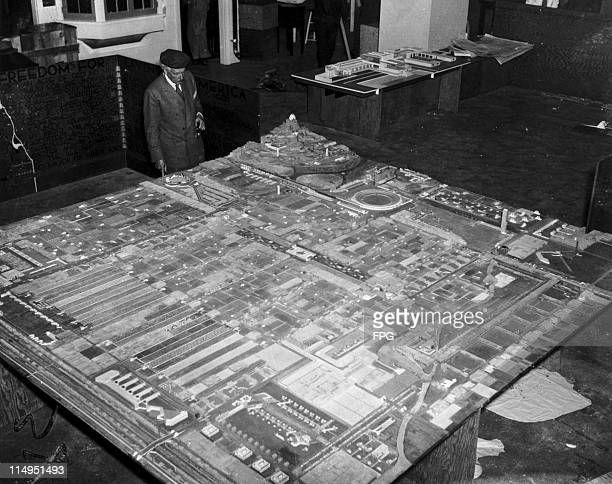 American architect Frank Lloyd Wright at the Rockefeller Center New York with a model of his 'Broadacre City' concept for suburban development 15th...