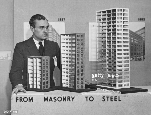 American architect Philip Johnson , Chairman of the Department of Architecture of the Museum of Modern Art, with models showing the evolution in...