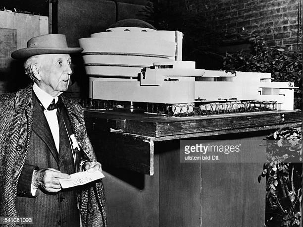 FRANK LLOYD WRIGHT American architect Wright beside his model for the Guggenheim Museum New York City Photographed 1953