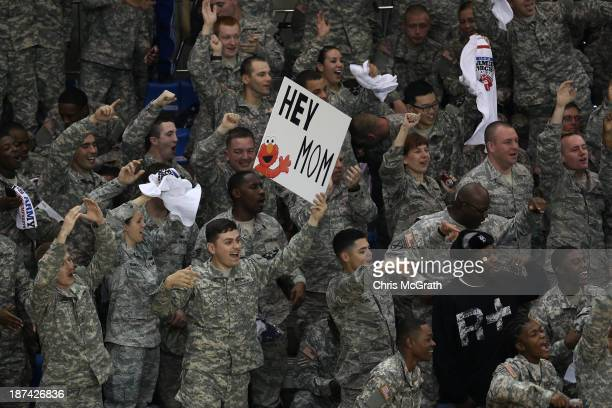 American Armed Forces personnel cheer and wave signs ahead of the start of the game between the Georgetown Hoyas and the Oregon Ducks during the...