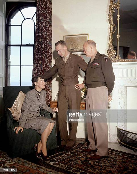 1946 American army General Dwight D Eisenhower and his son John talk to an unidentified seated woman