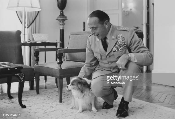 American Army general Lyman Lemnitzer Supreme Allied Commander Europe of NATO with a small sized dog UK 8th August 1963