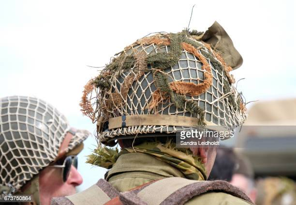 american army helmets worn by reenactors - denver st. patricks day parade stock pictures, royalty-free photos & images