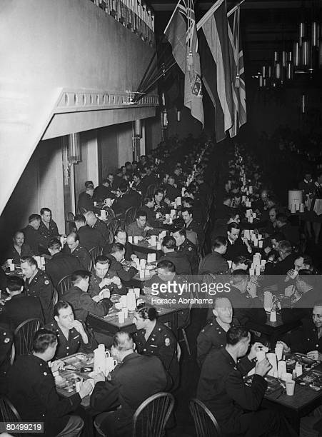 American Army officers dining at an officer's mess set up on the former skating rink at the Grosvenor House Hotel London 21st April 1944