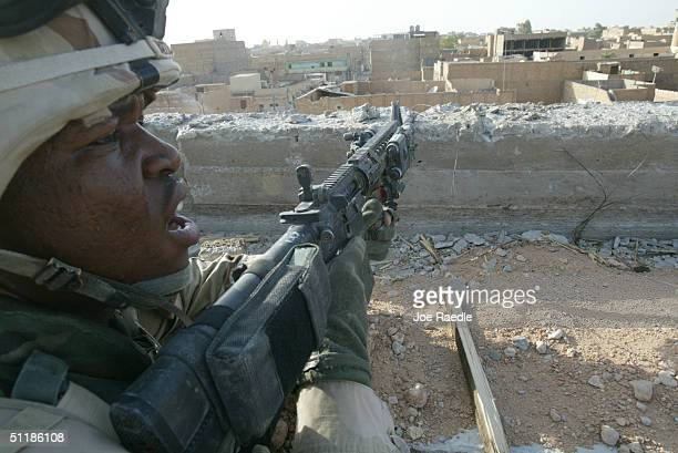 American army Sergeant Terrance Batts from the 1st Cavalry Division 2nd Battalion 7th Cavalry clears a building during fighting with Shiite militia...