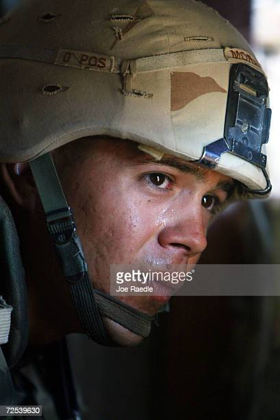American Army Specialist Michael Morales from San Antonio Texas of the 1st Cavalry Division 2nd Battalion 7th Cavalry looks for enemy fighters near...