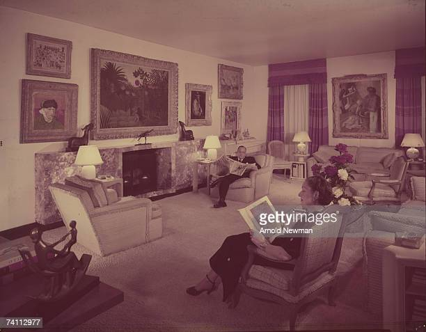 American art collector and steel executive Leigh B Block and his wife Mary Block read in their living room Chicago Illinois July 1952 The home was...
