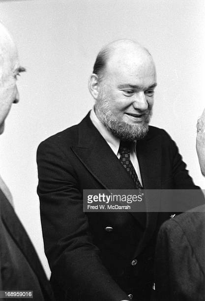 American art dealer Harry Lunn Jr speaks with unidentified people at an exhibition at the Marlborough Gallery New York New York September 15 1976