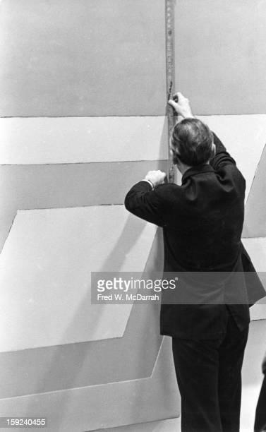 American art dealer Leo Castelli measures a canvas New York New York March 5 1966