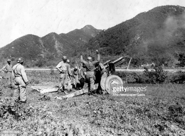 American artillery firing on the Communist led North Korean invaders during the Korean War Korea July 25 1950