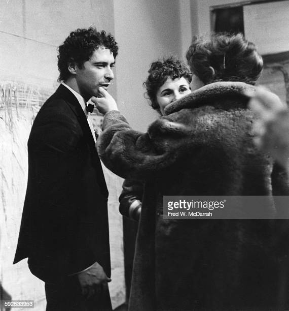 American artist and film director Alfred Leslie talks to guests during the opening of his exhibition at the Martha Jackson gallery New York New York...