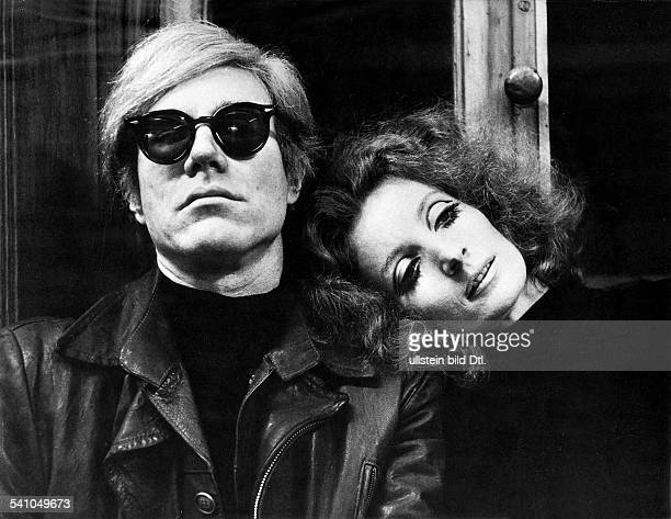 ANDY WARHOL American artist and filmmaker Shown with actress Viva in his film 'Blue Movie' 1968