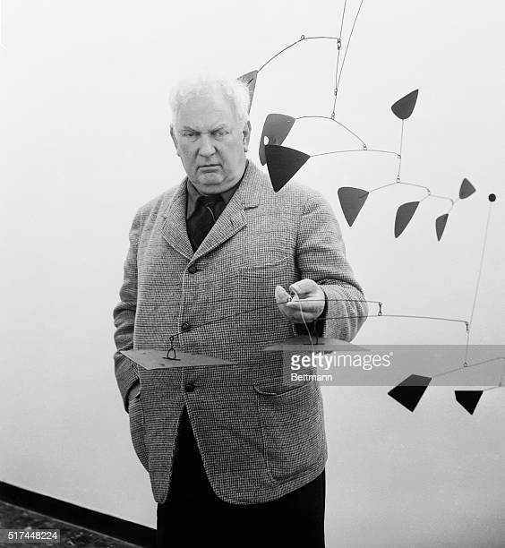 American artist and sculptor Alexander Calder a pioneer artist in the Mobile art form poses with some of his creations which are on exhibit in Rome...