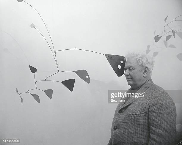 American artist and sculptor Alexander Calder a pioneer artist in the 'Mobile' art form poses with some of his creations which are on exhibit in Rome...