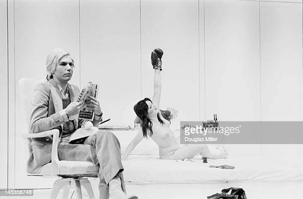 American artist Andy Warhol and actress Cherry Vanilla at a photocall following a dress rehearsal of Warhol's play 'Pork' at the Roundhouse London...