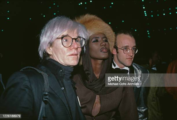 American artist Andy Warhol , Jamaican model and singer Grace Jones, and American artist Keith Haring attend an American Foundation for AIDS Research...