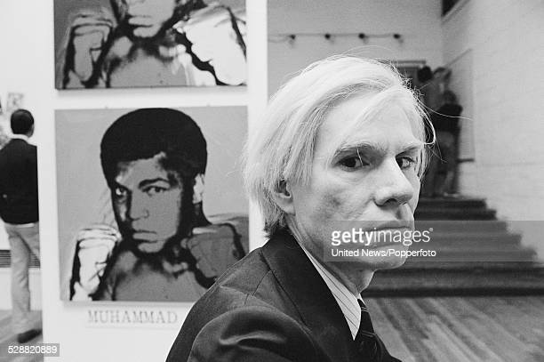 American artist Andy Warhol pictured at an art exhibition featuring his paintings of the boxer Muhammad Ali in London on 21st June 1978