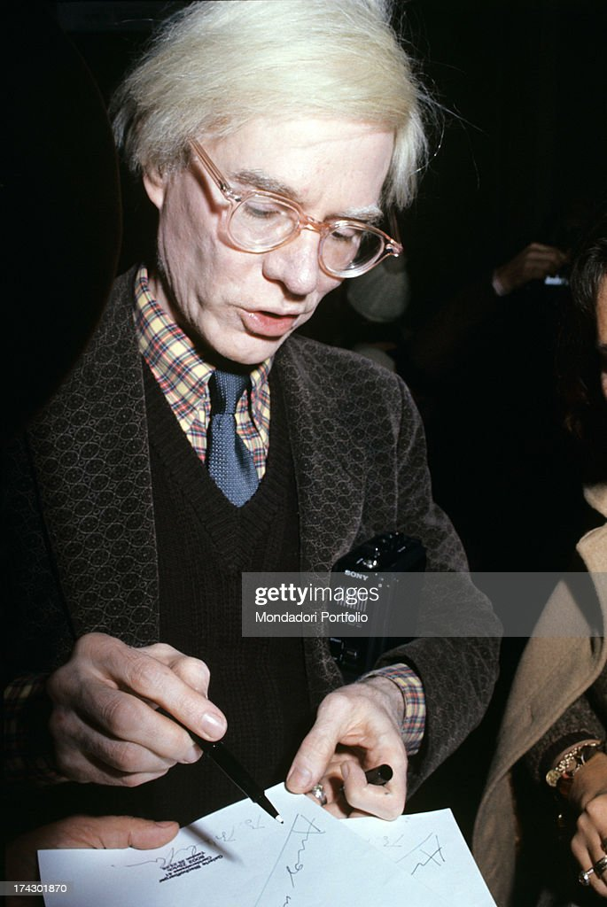 1db4c5035dc American artist Andy Warhol smiling attending his exhibition set up ...