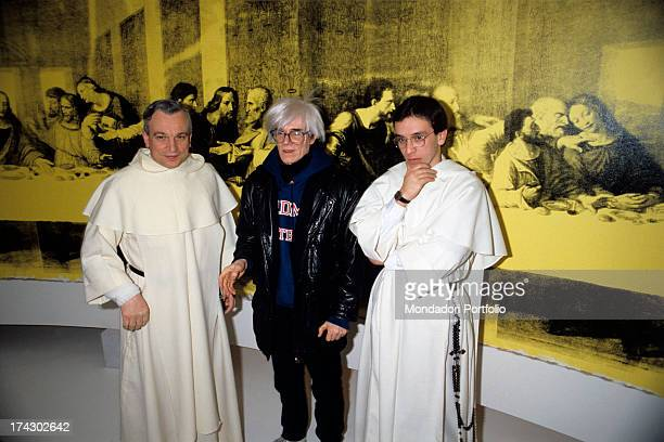 American artist Andy Warhol watching German publisher Inge Feltrinelli showing a part of the painting The Last Supper Milan 1986