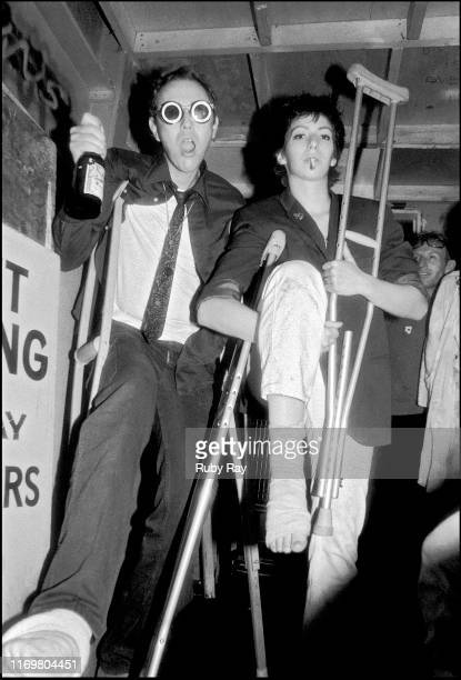 American artist Bruce Conner holding a bottle of Budweiser with friend Joann, on crutches, at the Mabuhay Gardens in San Francisco, California, US,...